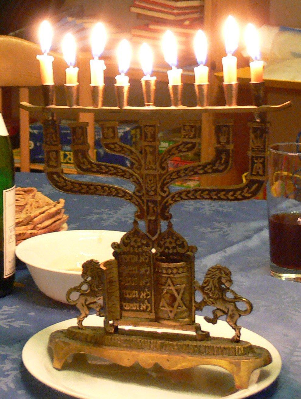 Chanukah menorah on blue tablecloth