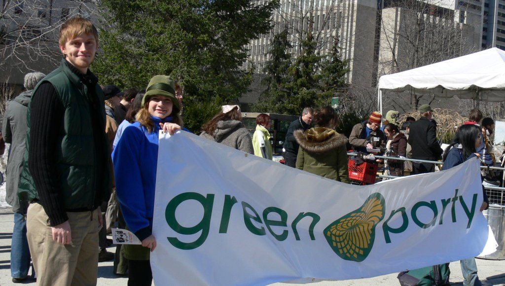 Chris Tindal with a Green Party banner