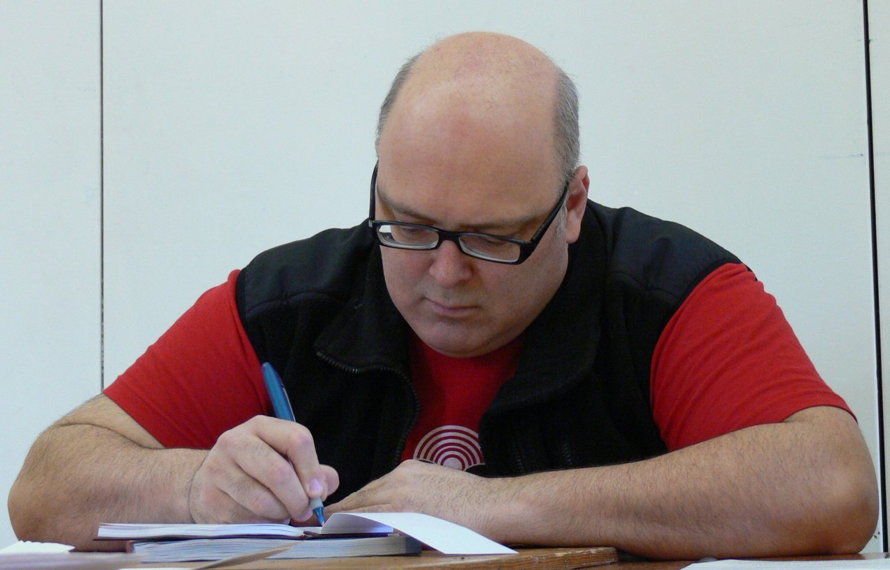 Ron Chambers writing at a campaign meeting