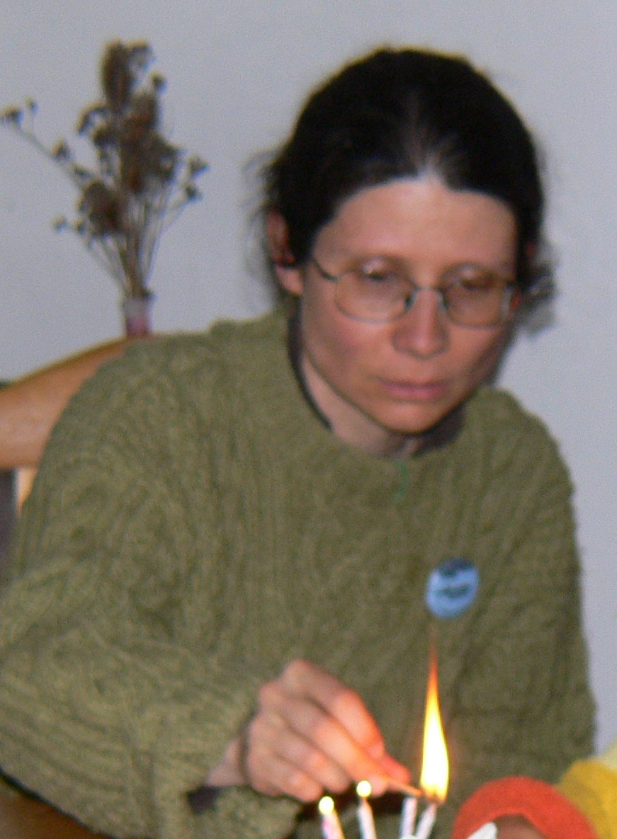 Adriana Mugnatto-Hamu lighting a candle