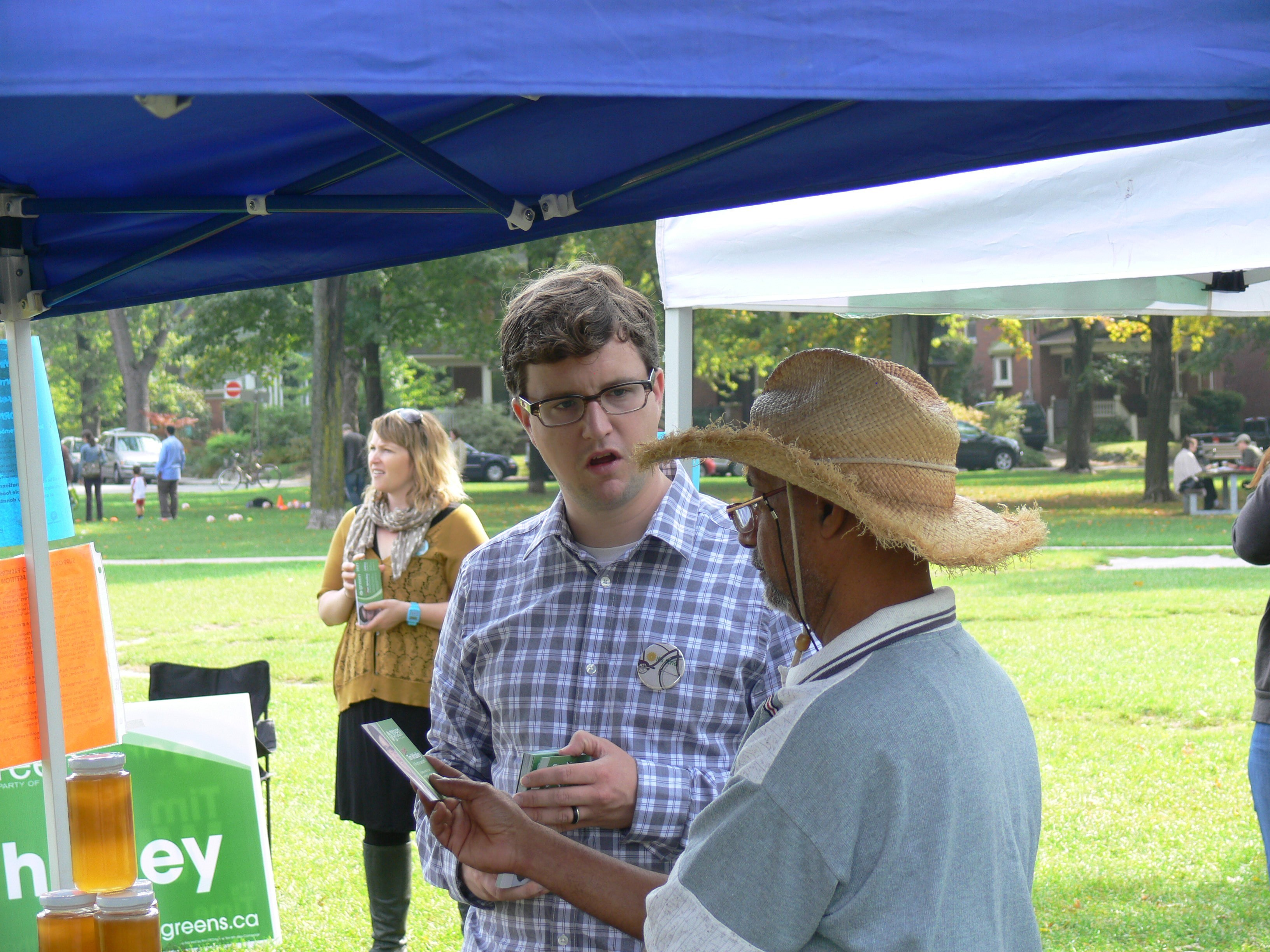 Toronto-Danforth candidate Tim Whalley talks to a bee farmer